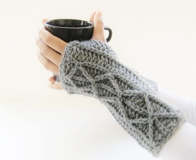 This fingerless gloves crochet pattern features a faux cable design that is unique and perfect for beginner crocheters. Make yours today.