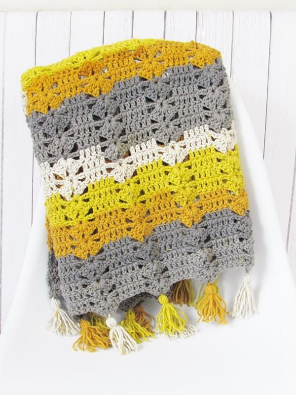 A Free Crochet Afghan Pattern made with the gorgeous Caron Cakes yarn.