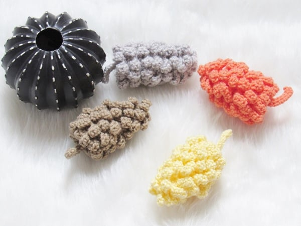 A cute crochet decor for your home, Amigurumi Pinecones. The perfect project to use up that leftover skeins of yarn. Try the free crochet pattern today. #crochetdecor, #crochetfalldecor, #amigurumi, #crochetpinecones