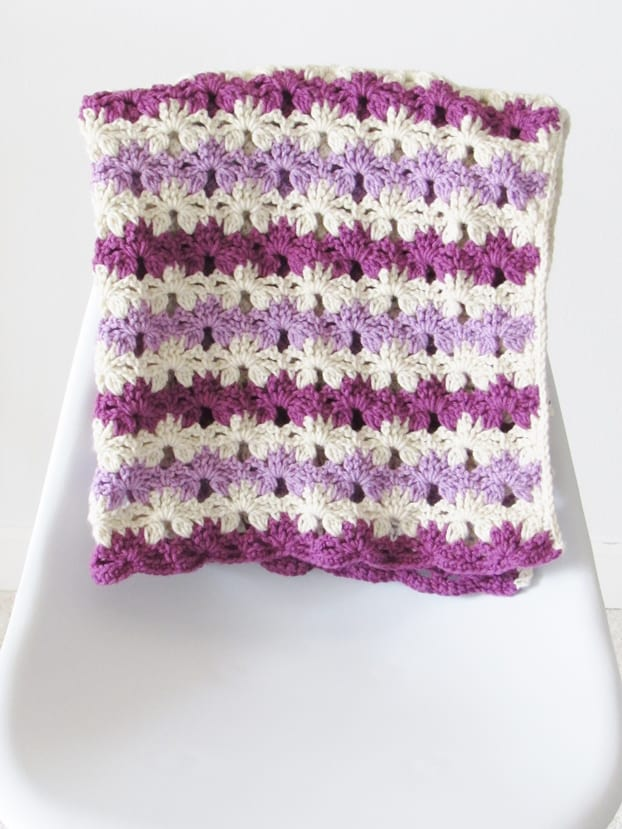 This crochet blanket for baby is a great unisex pattern, The stitch used is simple yet beautiful. Try making one today.