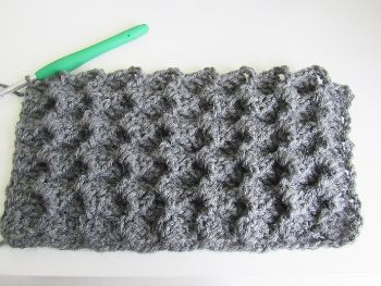 Close up of stitch pattern for diy crochet blanket cardigan